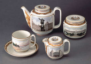 Teapot (-88a/b): cylindrical, rounded at base and top, long wide spout, large flat loop handle, disk-shaped lid. Painted in polychrome enamel, one side with picture of Evseyev's statue of Lenin, and on opposite side with gilded image of St. Isaac's Cathedral; gilded ornament of flags on sides of spout,ribbon border top of body, emblem on top of lid, flat side of handle. Sugar bowl (-89a,b), cylindrical, rounded at base and top, disk-shaped lid; painted in polychrome enamel, ribbon border top of body, emblem on top of lid. Cream pitcher (-90a,b): cylindrical, rounded at base and top, curved spout, wide loop handle, disk-shaped lid; painted in polychrome enamel on front with picture of the Gorky Palace of Culture and on back a griffin from Bankovsky Bridge in gilding; gilded ornament of ribbon border around top of body, flags along sides of spout, emblem on lid, on handle. Cup and saucer (-91a,b): cylindrical cup, rounded at base, loop handle; painted on front in polychrome enamel with picture of the Peter and Paul Fortress and Kirovsky (Troitsky) Bridge over Neva River, back has gilded image of Egyptian sphinx from Embankment at University Wharf. Circular saucer has gilded ribbon border around outer edge. Cup (-92): Cylindrical, rounded at base, loop handle; painted on front with polychrome enamel image of Peter and Paul Fortress and Kirovsky (Troitsky) Bridge over Neva River, on back gilded image of Egyptian Sphinx from Embankment at University Wharf.