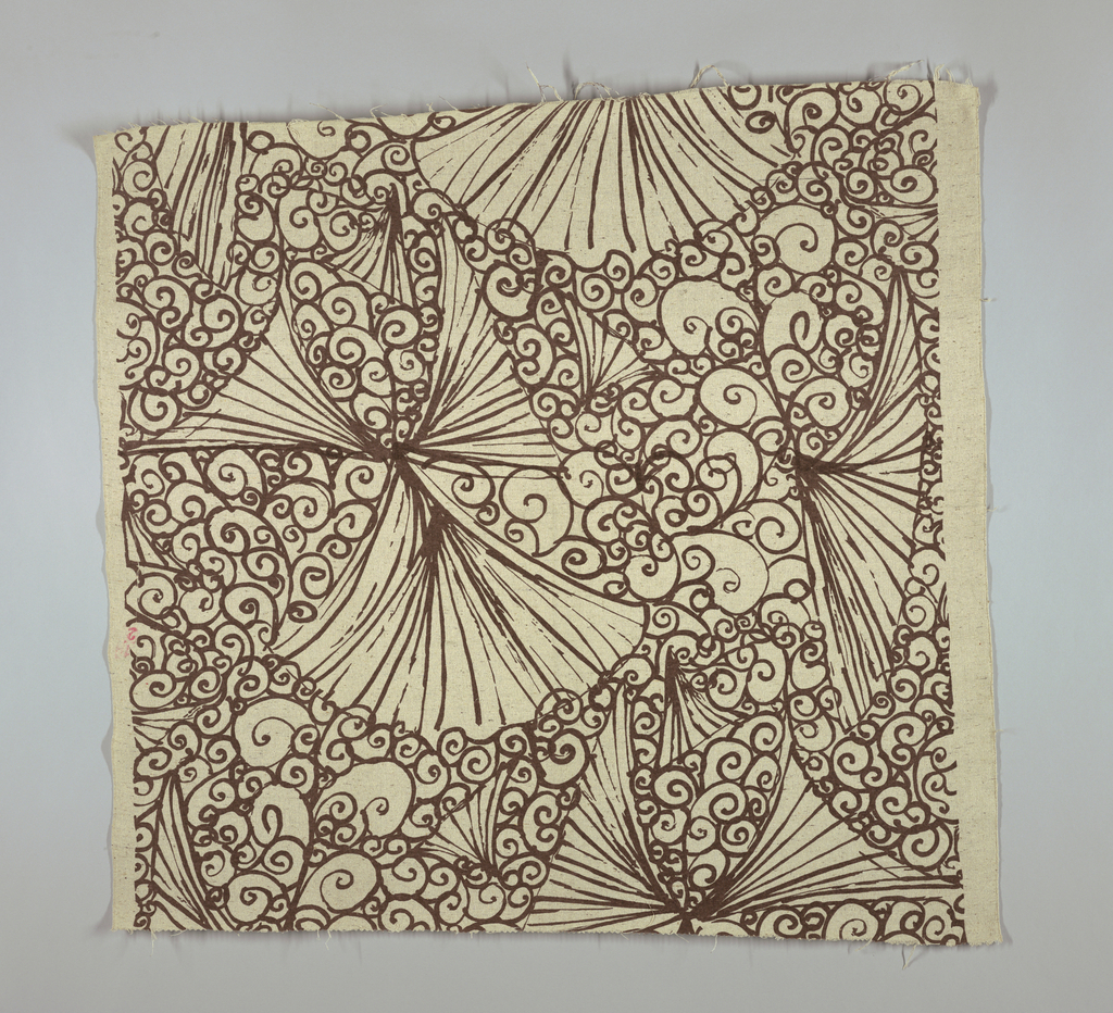 Oatmeal colored cloth with various flecks, mostly brown. Printed with a linear design suggesting crude woodblock of spreading fans on a ground of curlicues.