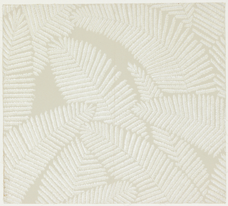 Design of overlapping fern leaves in silver and white on gray ground.