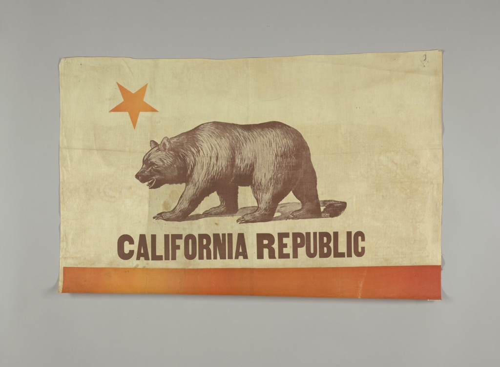California state flag, with a yellow star, large bear in the center, CALIFORNIA REPUBLIC below, and an orange/red band at the bottom.
