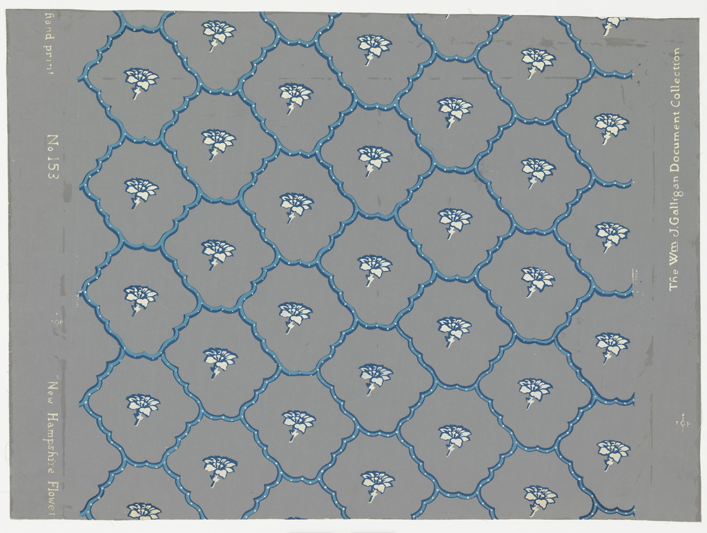 Network of blue scalloped bands forming rough hexagons which enframe a white flower. Printed on gray ground.