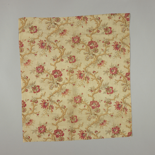 Length of printed cotton with half-drop repeat of flowers on a curved branch. Many colors on a tan background, in the style of the 18th century.