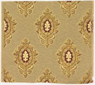 On grey and tan patterned ground, alternating medallions of metallic gold and silver; deep burgundy ground with gold and silver metallic motif at the center.