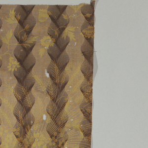 Two fragments with brown ground showing a striped pattern of curved columner design in dark brown, over printed in yellow, in a pattern of cornucopia and wheat.