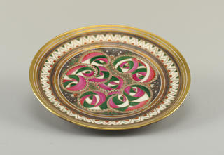 Decorated in green, pink and gold on white background. At center, an abstracted rose pattern; chevron at border.