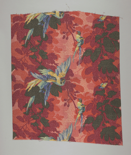 Polychrome block print. Blue, green, and yellow feathered birds and butterfly perch on foliage which is mottled shades of red, dark orange, light orange, and black.