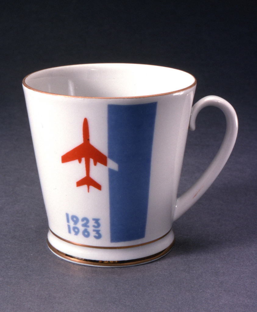 """Cylindrical, loop handle; with image of airplane and """"1923/1963"""" on one side, """"Aeroflot"""" (in Russian) on other side."""