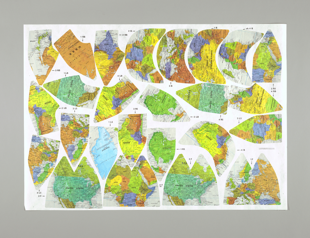 Sheet printed with parts of map of the world in sections as would be made up into baseball hats. The parts of 4 hats are printed on each sheet.