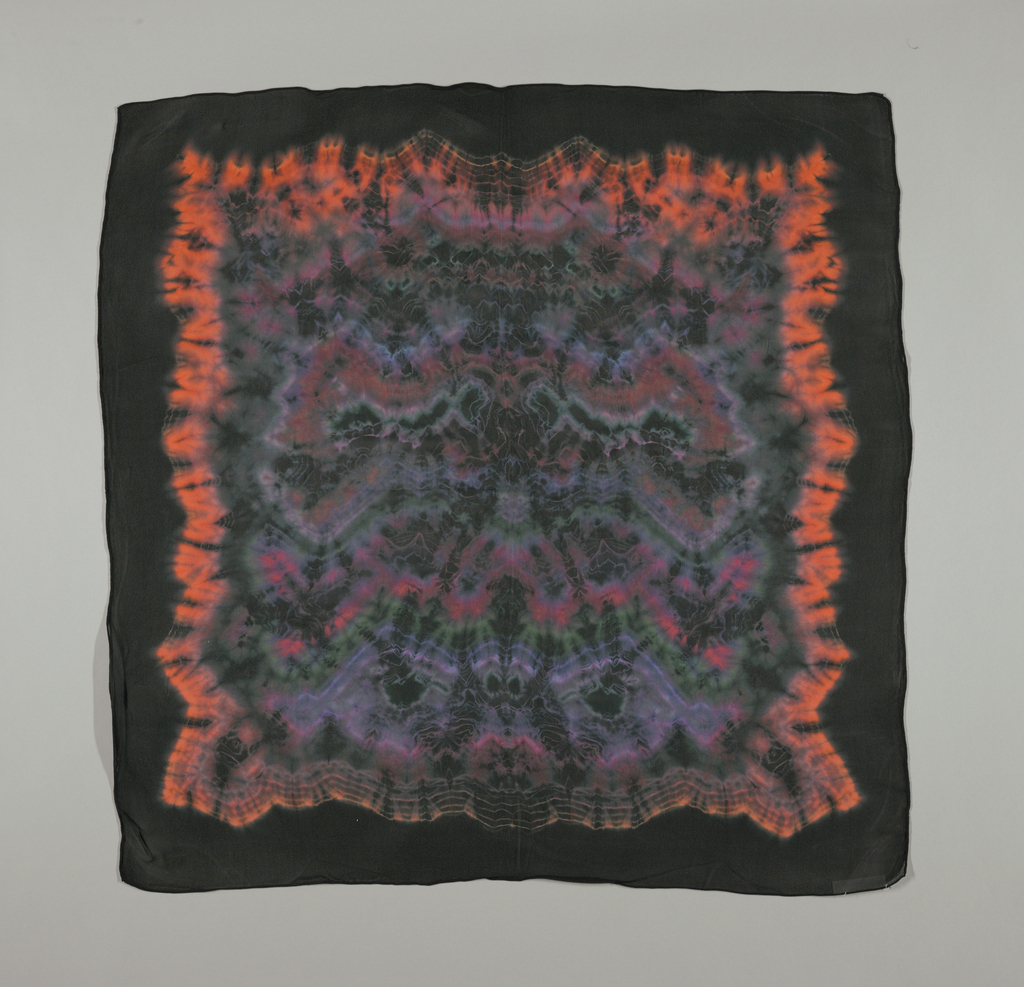 Black background with multi-colored tie-dye pattern.