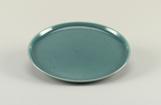 "Ceramic dinner ware in ""Seafoam"" color, consisting of a) cup, b) saucer, c) dinner plate, d) salad plate, e) dessert bowl, f) creamer."