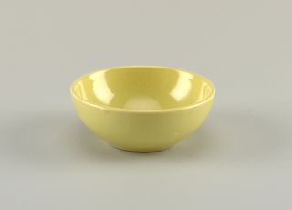 "Hemispherical form; ""avocado"" yellow-green glaze."
