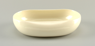 White oval dish with high curved edges.