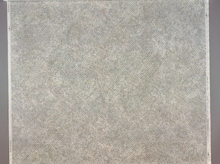 Length of printed cotton with a horizontal zigzag design of irregular silver dots on a mottled gray background.