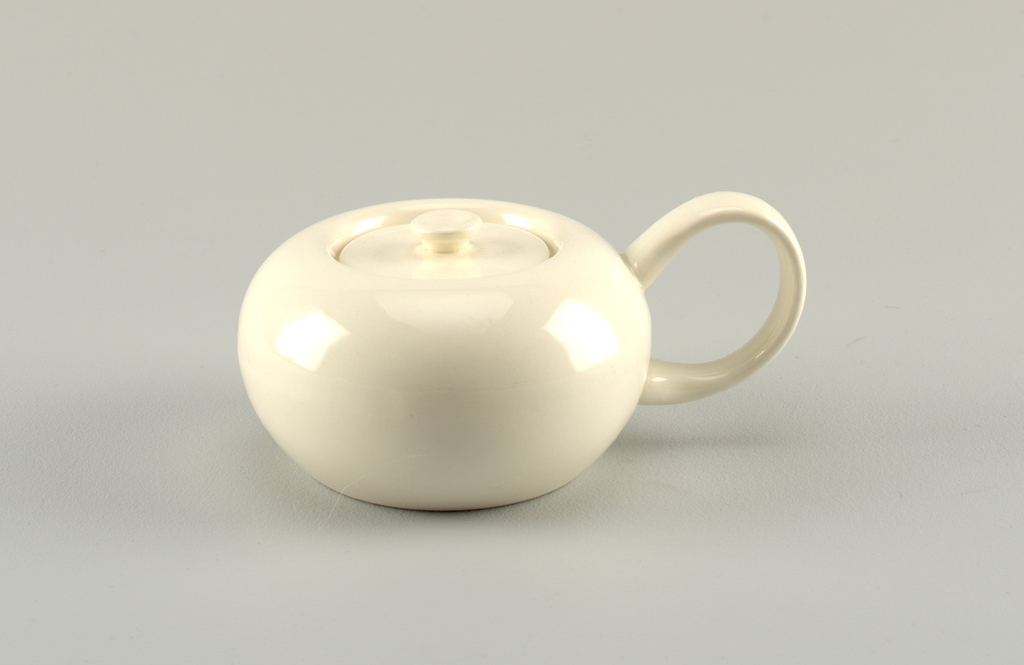 Round white bowl with flush lid and button finial; round loop handle.