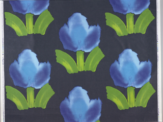 Large simple flower in blue and green on black. Watercolor effect.