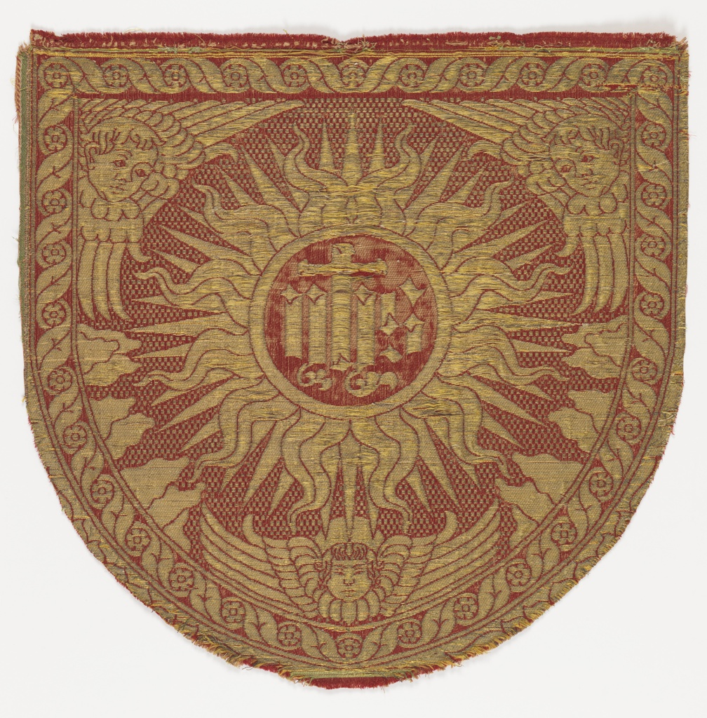 Central sunburst with cross and letters 'IHS'. Heads of three cherubs near border. Border of guilloche pattern with rosettes.