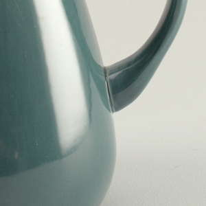 "Tall tear-shaped pitcher with tapered mouth rising to spout; angled D-form handle; ""seafoam green"" glaze."