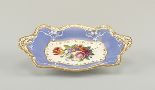 Rectangular dish with deeply scalloped edge, the scallops on the short ends extended to form handles that are pierced by two holes on each. Decoration same as on 1959-155-1.