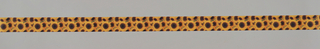 Ribbon in its cardboard packaging. Design of overlapping sunflowers in yellow, orange and brown.