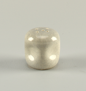 Gray ceramic piece pierced at the top with indentations on the sides.