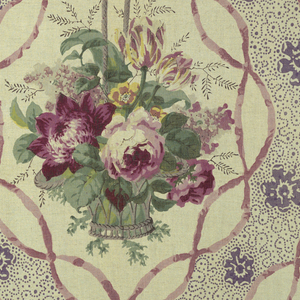 """Polychrome block print on natural linen. Off-set rows of oval framed basket of flowers. Frame made of twisting lavender ribbons. Basket of purple, yellow flowers with greenery. Between rows are areas of purple """"picotage"""" and purple flower heads."""