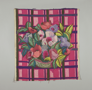 Multicolored block print of a grey-green bowl with large red, pink and lavender flowers with leaves in two shades of green. Bowl is placed on a plaid-like ground of deep pink, dark purple, and black.