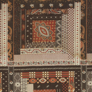 """Two fragments of printed cotton imitating patchwork: rows of squares of two types each traditionally called """"log cabin"""" in a stepped arrangement of bars enclosing a central square. Each shape has a small scale dotted or floral pattern (several Indian Paisley type) in dark browns and rust-reds."""