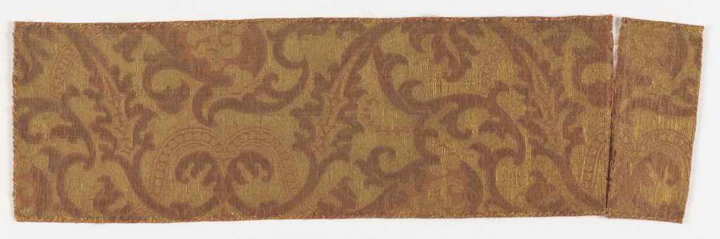Swirking scrolls and leaves in mauve, brown and yellow.