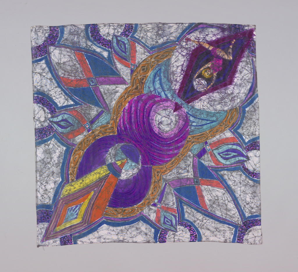 Square scarf in a pattern of two large swirling circles in purples, reds and luminous blue-greens. Diamond shapes just toward the corners; in one, a figure of a running man holding a ball above his head. Signed in corner and hand hemmed.