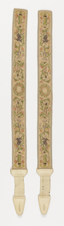 Pair of suspenders of heavy silk mesh. Embroidered in colored silks in a vine design with small Chinese figures. Lined with magenta and white plaid taffeta. White leather straps and points to fashion to trousers.