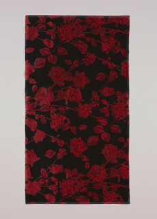 Black ground has an allover pattern of red roses with red leaves and stems.