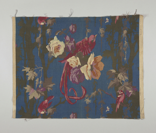 Polychrome block print on dark blue linen. Large maroon and pink bird with long tail feathers sits on cluster of large flowers: lavender and purple, white, tans, pale green. At either side are long black branches with grey and purple leaves with smaller red and pink birds. Sides match at 1/2 drop repeat. Condition: dirty