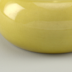 Olive green round bowl with handle and flush lid with button finial.