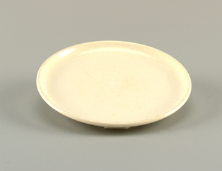 Glazed white salad plate.