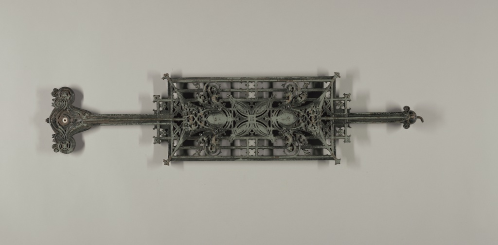 Balustrade panel from an interior stairway. Stylized leaves and berries form a symmetrical arrangement.