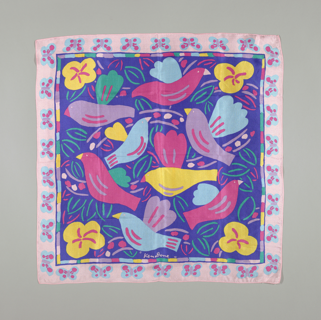 Scarf with pink border and blue center that is printed with pink, yellow, blue, and lavender birds and yellow flowers.