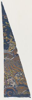 Deep blue ground with an incomplete broad border design of waves, bat and flower forms brocaded in multicolored silks and gold. Triangular-shaped fragment.