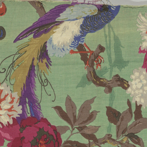 On a green ground, exotic birds plucking fruit from branches above are in shades of dark pink, purple, blue and orange.