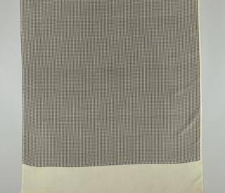 The CBS Eye printed in black on beige silk.