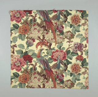 Large-scale design of pheasants, peonies, berries and foliage on a meandering tree trunk, on a light brown strie ground. Many shades of red, green, lavender and brown.
