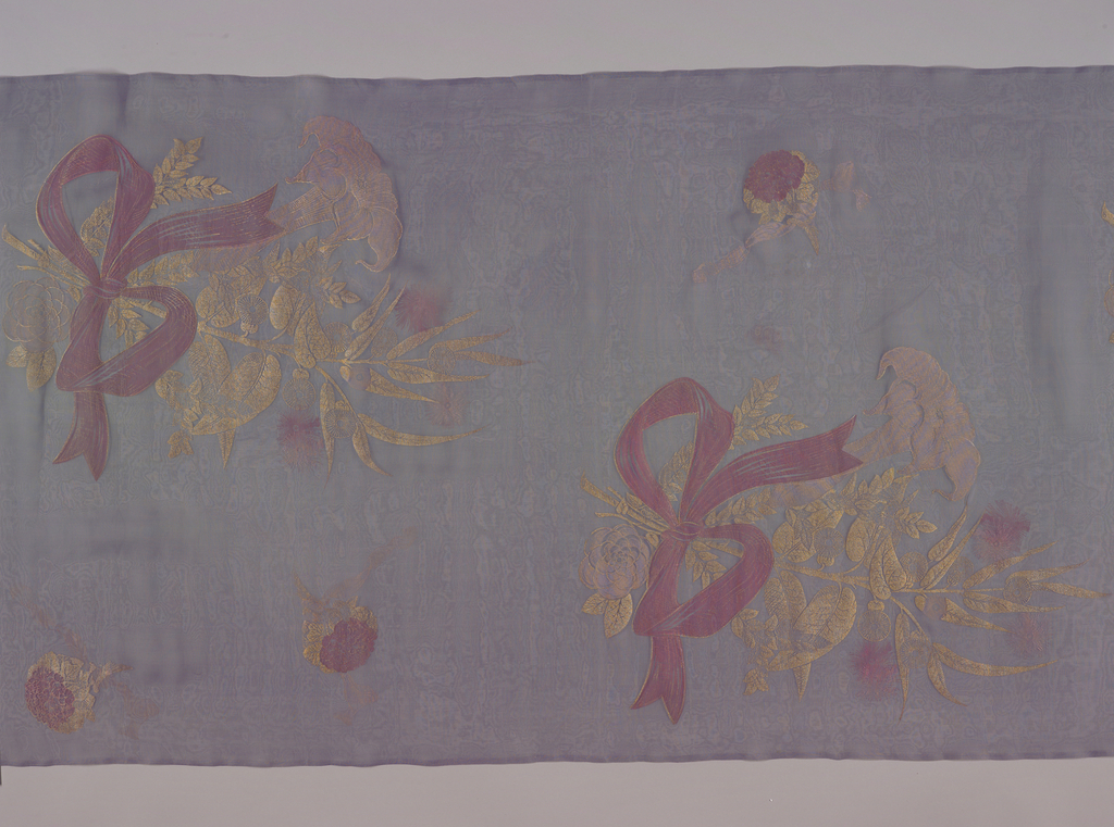 Violet silk organdy printed with widely spaced stylized bouquets in gold and soft pink, tied with a ribbon.
