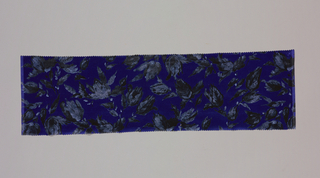 Blue ground has an allover floral pattern with short stems and leaves in dark and light gray.