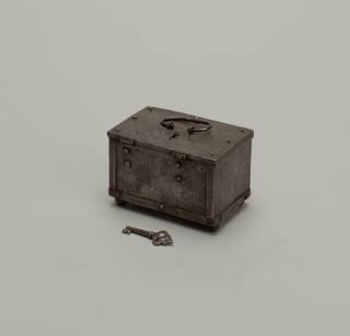Rectangular box with engraved decoration of floral scrolls; lock with key on top
