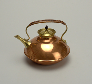 Ovoid copper and brass kettle with scrolling handle wrapped in cane; carved wood finial on lid. Brass and copper tripod stand with central shaft decorated by copper foliate ornament; removeable brass burner at top of shaft.