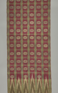 Ribbed silk woven in wide red stripes alternating with narrower green stripes. A detached rosette is brocaded in gold in the red stripes. Smaller gold rosettes and stylized ornaments are in the green stripes. Ikat patterning in white and brown at either end.