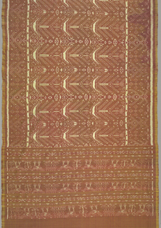 Warps are bright yellow and wefts are ikat dyed in dark red with areas reserved in white. the pattern of the central field is composed of highly stylized tree (?) forms and geometric motifs. A broad band at either end is divided into horizontal units within which are stylized animal and geometric forms.