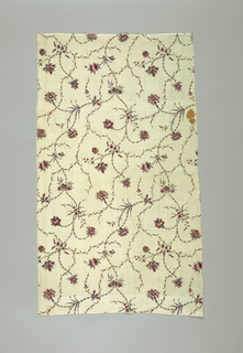 Cream colored cotton, block-printed in design of flowers and delicate intertwining garlands of thin pointed leaves and stems. Blossoms show remains of Indian influence. Some appear to be carnations. Colors red, blue, sepia for stems, and violet. No selvages.
