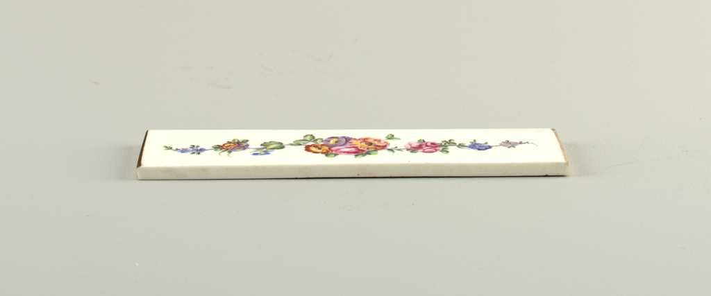 Rectangular plaque decorated with central clusters of rose and anemones, and serpentine sprays of roses, anemones and morning glories, foliage.