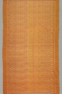 Length of soft handwoven silk with weft ikat patterning. Small, flattened diamond pattern in horizontal, staggered rows. Predominantly orange with green, pale yellow, red-violet, and white in the pattern areas.