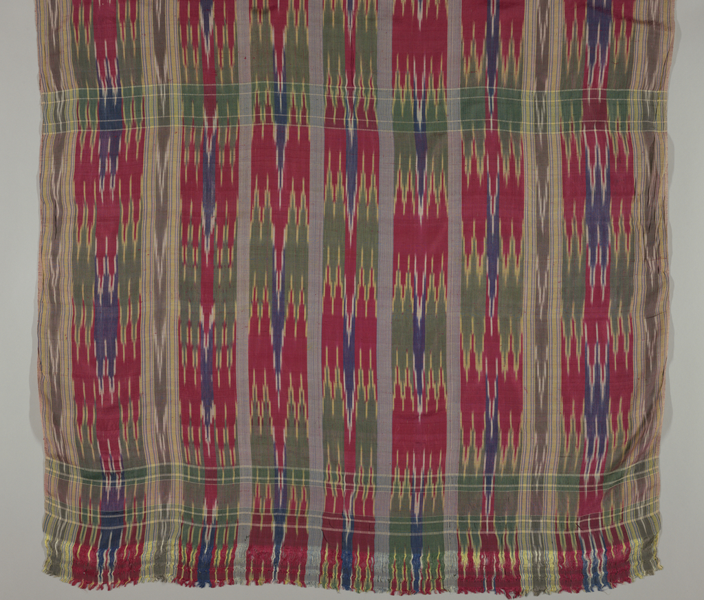 Plain and ikat stripes in red, green, purple, and yellow crossed by occasional weft bands to form a plaid pattern.